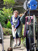 BNPS.co.uk (01202 558833)<br /> Pic: HostUnusual/BBC<br /> <br /> Kathy Staff filming LOTSW...<br /> <br /> Fans of TV sitcom Last of the Summer Wine are booking out the iconic cottage where unlikely sex symbol Nora Batty lived after it has been turned into a holiday let.<br /> <br /> The exterior of the terraced house in Holmfirth, West Yorks, featured in dozens of episodes of the much-loved BBC show.<br /> <br /> Yorkshire battleaxe Nora Batty - played by the late actress Kathy Staff - was more often than not filmed sweeping the steps of the two bedroom cottage and chasing off the unwanted attentions of Bill Owen's character Compo.<br /> <br /> In real life the property - 28 Huddersfield Road - is owned by Richard and Loretta Skelton who run it as a successful self-catering holiday home.