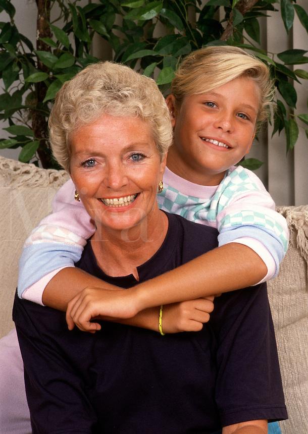 A smiling, hugging grandmother and gradddaughter.
