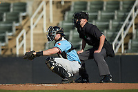 Hickory Crawdads catcher Matt Whatley (19) sets a target as home plate umpire Matt Baldwin looks on during the game against the Kannapolis Intimidators at Kannapolis Intimidators Stadium on May 6, 2019 in Kannapolis, North Carolina. The Crawdads defeated the Intimidators 2-1 in game one of a double-header. (Brian Westerholt/Four Seam Images)