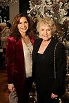 Diana Garcia and Alma Garcia at the M.D. Anderson Santa's Elves party Thursday Dec. 07,2017. (Dave Rossman Photo)