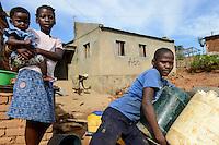 MOZAMBIQUE, Moatize, Cabanga settlement will be demolished for the extension of Rio Tinto coal mine, the peoples will be resettled in Mwaladzi 40 km away, the houses are marked with registration numbers / MOSAMBIK, Moatize, fuer die Erweiterung der Benga Kohlemine von Rio Tinto, wurde 2014 an das indische Konsortium ICVL verkauft, wird die Ortschaft Cabanga abgerissen, die Bewohner werden 40 km von Moatize enfernt nach Mwaladzi umgesiedelt, die Haeuser haben bereits eine Zahlenmarkierung von der Kohlegesellschaft