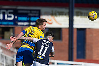 3rd April 2021; Dens Park, Dundee, Scotland; Scottish FA Cup Football, Dundee FC versus St Johnstone; Jason Kerr of St Johnstone heads clear from Declan McDaid of Dundee