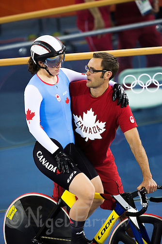 03 AUG 2012 - LONDON, GBR - Canadian Head Track Coach Richard Wooles prepares Monique Sullivan (CAN) of Canada for the Women's Keirin final during the London 2012 Olympic Games track cycling in the Olympic Park Velodrome in Stratford, London, Great Britain (PHOTO (C) 2012 NIGEL FARROW)
