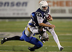 Nevada's Cody Fajardo (17) tries to break a tackle from San Jose State's Sean Bacon (95) during the first half of an NCAA college football game in Reno, Nev., on Saturday, Nov. 16, 2013.<br /> (AP Photo/ Cathleen Allison).