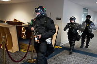 Members of a Secret Service tactical team arrive as Senators evacuate to a safe place in the Dirksen Senate Office Building after Electoral votes being counted during a joint session of the United States Congress to certify the results of the 2020 presidential election in the US House of Representatives Chamber in the US Capitol in Washington, DC on Wednesday, January 6, 2021, as interrupted as thousands of pr-Trump protestors stormed the U.S. Capitol and the House chambers.  .<br /> CAP/MPI/RS<br /> ©RS/MPI/Capital Pictures
