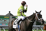 Jockey Julien Leparoux checks the tote board awaiting a decison after winning the 5th race by a nose on Spanish Empiress. October 29, 2011.