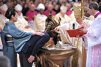 Pope Benedict XVI baptises as he celebrates a Easter Vigil mass in Saint Peter's Basilica at the Vatican 03 April 2010.