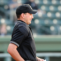 Umpire Brian Miller works a game between the Greenville Drive and Augusta GreenJackets on April 19, 2012, at Fluor Field at the West End in Greenville, South Carolina. (Tom Priddy/Four Seam Images)