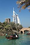 United Arab Emirates, Dubai: Abra tour on the waterways of the Madinat Jumeriah with the Burj al Arab in the background