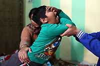 A young child doing stretching exercises as part of therapeutic treatment at the Baba Farid Center for Special Children in Faridkot, Punjab. Scientists believe that excessive pesticide use in the region over the past 30-40 years has led to the accumulation of dangerous levels of toxins such as uranium, lead and mercury which are contributing to increased health problems in rural communities. Many children are now being born for physical and mental disabilities. It's a hidden epidemic which is gripping the Punjab region in northeast India which for decades has been the country's 'bread basket'. Local farmers and their families are now paying the price for the country's 'Green Revolution'.