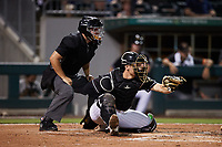 Charlotte Knights catcher Nate Nolan (28) frames a pitch as home plate umpire Jonathan Parra looks on during the game against the Norfolk Tides at Truist Field on August 19, 2021 in Charlotte, North Carolina. (Brian Westerholt/Four Seam Images)