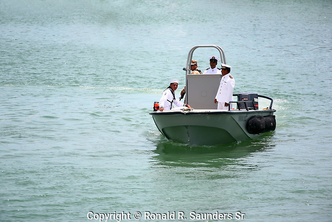 Mexican military representatives in small watercraft. <br />  The occasion is a cause for pride in the Mexican navy. (2)