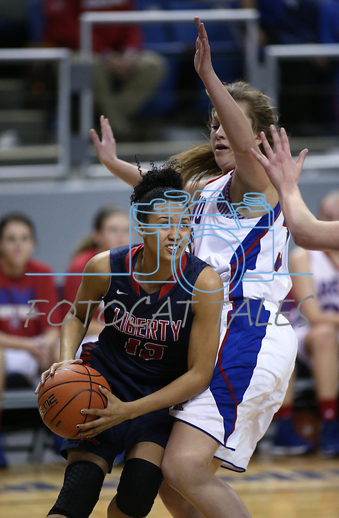 Liberty's Aubre' Fortner drives past Reno's Morgan McGwire during the Division I championship game in the NIAA basketball state tournament at Lawlor Events Center, in Reno, Nev., on Friday, Feb. 28, 2014. Reno won the state title 50-39. (Cathleen Allison/Las Vegas Review-Journal)