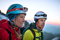 Two climbers stopped and smiling while on the Weissmies, Switzerland