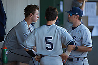Xavier Musketeers Sam Czabala (left) listens to picthing coach Nick Otte (13) as Nate Soria (5) looks on during the game against the Penn State Nittany Lions at Coleman Field at the USA Baseball National Training Center on February 25, 2017 in Cary, North Carolina. The Musketeers defeated the Nittany Lions 10-4 in game one of a double header. (Brian Westerholt/Four Seam Images)