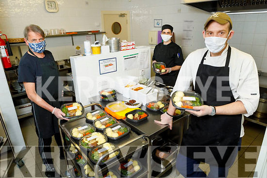 Volunteers working getting the Listowel Family Meal Time food ready at the Listowel Family Resource Centre on Bank Holiday Monday.<br /> Front: Chef Ger Lennihan (Eabha Joans).<br /> Back l to r: David Mulvihill (Great Southern Hotel Killarney) and Daniel Costello.