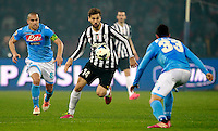 Calcio, Serie A: Napoli vs Juventus. Napoli, stadio San Paolo, 30 marzo 2014. <br /> Juventus forward Fernando Llorente, of Spain, center, is challenged by Napoli midfielder Gokhan Inler, of Switzerland, left, and defender Raul Albiol, also of Spain, during the Italian Serie A football match between Napoli and Juventus at Naples' San Paolo stadium, 30 March 2014.<br /> UPDATE IMAGES PRESS/Isabella Bonotto