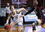 SIOUX FALLS, SD - MARCH 6: Haley Greer #11 of the South Dakota State Jackrabbits drives past Josie Filer #25 of the Omaha Mavericks during the Summit League Basketball Tournament at the Sanford Pentagon in Sioux Falls, SD. (Photo by Richard Carlson/Inertia)