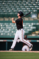 GCL Orioles third baseman Jared Gates (18) follows through on a swing during the first game of a doubleheader against the GCL Twins on August 1, 2018 at CenturyLink Sports Complex Fields in Fort Myers, Florida.  GCL Twins defeated GCL Orioles 7-6 in the completion of a suspended game originally started on July 31st, 2018.  (Mike Janes/Four Seam Images)