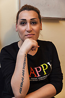 """Armenia. Yerevan. Lilit Martirosyan is a transgender woman. She is a civil rights activist fighting for the rights of trans people in Armenia. On her right arm, a tattoo with the words """" All Equal All Different"""". She is the founder and the president of the NGO called """"Right Side"""", founded in 2016 to defend and fight for the rights of the trans community in Armenia. Lilit Martirosyan became on April 5th 2019 the first member of her country's lesbian, gay, bisexual, transgender and intersex (LGBTI) community to deliver a speech on the parliamentary podium, speaking out against discrimination at a session of its committee on human rights. A trans woman (sometimes trans-woman or transwoman) is a woman who was assigned male at birth. Trans women may experience gender dysphoria and may transition; this process commonly includes hormone replacement therapy and sometimes sex reassignment surgery, which can bring immense relief and even resolve gender dysphoria entirely. Yerevan, sometimes spelled Erevan, is the capital and largest city of Armenia. 30.09.2019 © 2019 Didier Ruef"""
