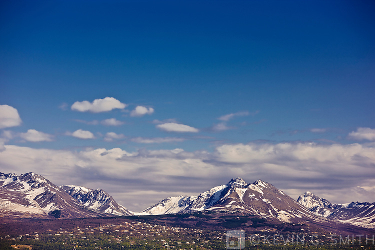View of the Chugach mountains from midtown Anchorage, spring foliage, Anchorage, Southcentral Alaska, USA.