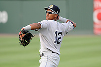 Second baseman Jose Rosario (12) of the Charleston RiverDogs before a game against the Greenville Drive on Wednesday, June 12, 2013, at Fluor Field at the West End in Greenville, South Carolina. Charleston won, 10-5. The teams wore their Boston and New York affiliate uniforms as part of a promotion. (Tom Priddy/Four Seam Images)