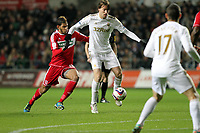 League Cup, Swansea City (white) V Middlesbrough, Liberty Stadium, 12/12/12<br /> Pictured: Michu holds off Faris Haroun<br /> Picture by: Ben Wyeth<br /> Athena Picture Agency<br /> info@athena-pictures.com