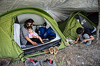Pictured: A young mother holds her young daughter in her tent.<br /> Re: Everyday life at the Moria refugee camp on the island of Lesbos, Greece.
