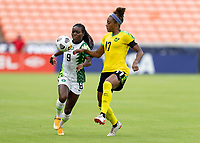 HOUSTON, TX - JUNE 10: Toni Payne #9 of Nigeria is defended by Allyson Swaby #17 of Jamaica during a game between Nigeria and Jamaica at BBVA Stadium on June 10, 2021 in Houston, Texas.