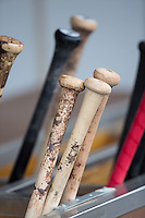 Baseball bats sit in a rack in the Gwinnett Braves dugout during the game against the Charlotte Knights at BB&T BallPark on May 22, 2016 in Charlotte, North Carolina.  The Knights defeated the Braves 9-8 in 11 innings.  (Brian Westerholt/Four Seam Images)