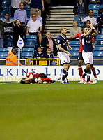 Ipswich Town's Joe Garner remains on the floor whilst Millwall's George Saville looks to the ref during the Sky Bet Championship match between Millwall and Ipswich Town at The Den, London, England on 15 August 2017. Photo by Carlton Myrie.