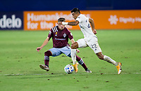 CARSON, CA - SEPTEMBER 19: Julian Araujo #22 of the Los Angeles Galaxy moves with the ball past Sam Vines #13 of the Colorado Rapids during a game between Colorado Rapids and Los Angeles Galaxy at Dignity Heath Sports Park on September 19, 2020 in Carson, California.