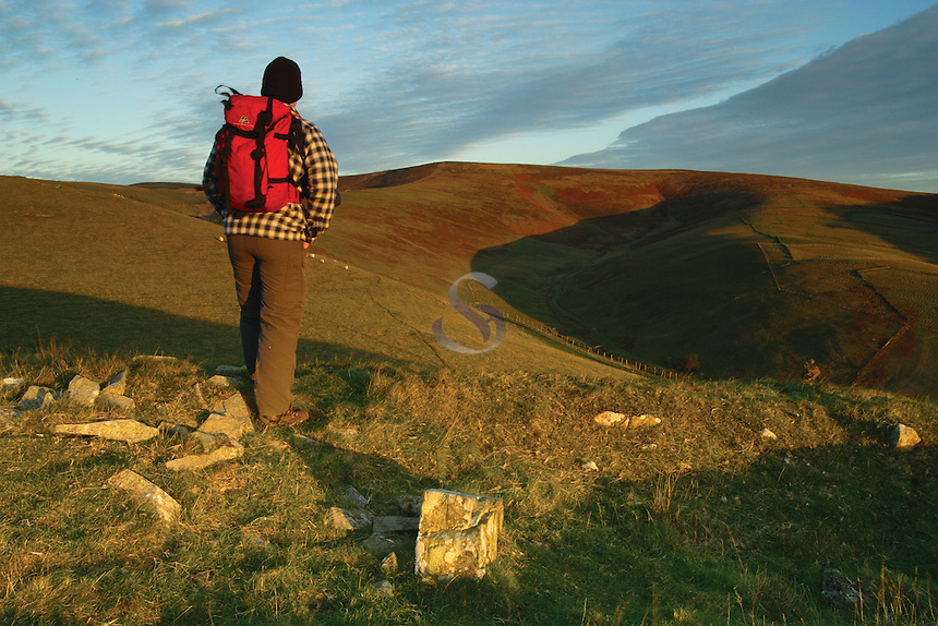 A walker looking towards Brown Knowe at dawn from the historic and ancient Minchmoor Road above the village of Yarrowford, Scottish Borders<br /> <br /> Copyright www.scottishhorizons.co.uk/Keith Fergus 2011 All Rights Reserved