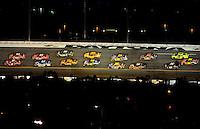 Feb 07, 2009; Daytona Beach, FL, USA; NASCAR Sprint Cup Series drivers race through turn three during the Bud Shootout at Daytona International Speedway. Mandatory Credit: Mark J. Rebilas-