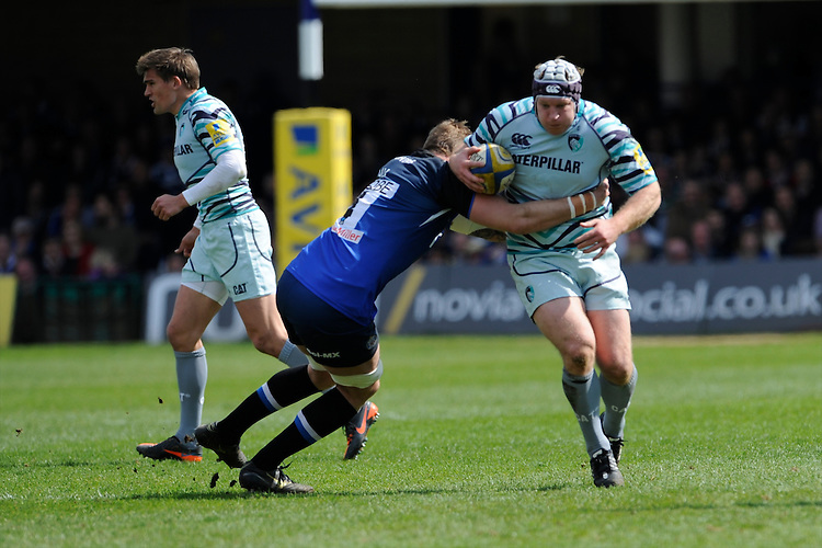 Thomas Waldrom of Leicester Tigers is tackled by Dominic Day of Bath Rugby during the Aviva Premiership match between Bath Rugby and Leicester Tigers at The Recreation Ground on Saturday 20th April 2013 (Photo by Rob Munro)
