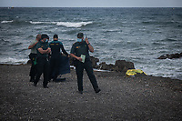 CEUTA, SPAIN ‐ MAY 20: Spanish Civil guards remove a body bag from the shore of Tarajal on May 20, 2021 in Ceuta, Spain.  After a diplomatic conflict between Spain and Morocco, thousands of migrants who have taken advantage of the little Moroccan police activity on the border to cross it mainly by swimming, which has caused a migration crisis with the entry of more than 8000 migrants from the African country. (Photo by Joan Amengual/VIEWpress )