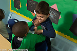 Education Preschool 3 year olds two boys play fighting with each other
