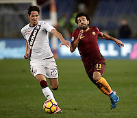 Calcio, Serie A: Roma, stadio Olimpico, 19 febbraio 2017.<br /> Roma's Mohamed Salah (l) in action with Torino's Sasa Lukic (r) during the Italian Serie A football match between As Roma and Torino at Rome's Olympic stadium, on February 19, 2017.<br /> UPDATE IMAGES PRESS/Isabella Bonotto