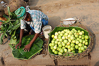 A man selling fruit in the Kolay market in central Kolkata.<br /> <br /> To license this image, please contact the National Geographic Creative Collection:<br /> <br /> Image ID: 1925825 <br />  <br /> Email: natgeocreative@ngs.org<br /> <br /> Telephone: 202 857 7537 / Toll Free 800 434 2244<br /> <br /> National Geographic Creative<br /> 1145 17th St NW, Washington DC 20036