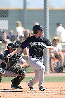 Tyler Kuhn #14 of the Colorado Rockies bats during a Minor League Spring Training Game against the San Francisco Giants at the Colorado Rockies Spring Training Complex on March 18, 2014 in Scottsdale, Arizona. (Larry Goren/Four Seam Images)