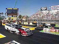 Mar 15, 2015; Gainesville, FL, USA; NHRA funny car driver Tim Wilkerson (near lane) races alongside Jack Beckman during the Gatornationals at Auto Plus Raceway at Gainesville. Mandatory Credit: Mark J. Rebilas-