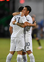 LAKE BUENA VISTA, FL - JULY 18: Sebastian Lletget #17 of LA Galaxy receives a hug from teammate Cristian Pavón #10 after scoring a goal during a game between Los Angeles Galaxy and Los Angeles FC at ESPN Wide World of Sports on July 18, 2020 in Lake Buena Vista, Florida.