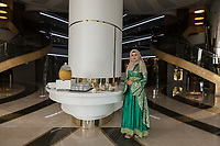 A woman serves welcome drinks to arriving guests in the lobby of the Wome Deluxe halal hotel in southern Turkey.