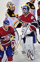 22 April 2009: Boston Bruins' goaltender Tim Thomas is congratulated by Montreal Canadiens goaltender Carey Price at the Bell Centre in Montreal, Quebec, Canada. The Bruins advance to the Eastern Semi-Finals, eliminating the Canadiens from Stanley Cup competition with their 4-1 win and series sweep. ***** Editorial Sales Only ***** Mandatory Credit: Ed Wolfstein Photo