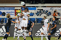 SAN JOSE, CA - SEPTEMBER 19: Marcos Lopez #27 of the San Jose Earthquakes goes up for a header with Jeremy Ebobisse during a game between Portland Timbers and San Jose Earthquakes at Earthquakes Stadium on September 19, 2020 in San Jose, California.