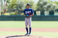 Los Angeles Dodgers relief pitcher Carlos Montilla (57) gets ready to deliver a pitch during an Instructional League game against the Oakland Athletics at Camelback Ranch on September 27, 2018 in Glendale, Arizona. (Zachary Lucy/Four Seam Images)