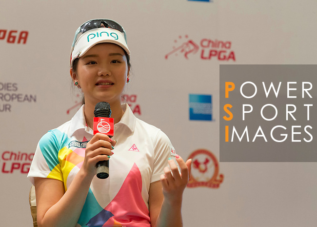 Shi Yuting speaks during the press conference at the beginning of World Ladies Championship 2016 on 09 March 2016 at Mission Hills Olazabal Golf Course in Dongguan, China. Photo by Victor Fraile / Power Sport Images