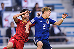 Doan Ritsu of Japan (R) fights for the ball with Doan Van Hau of Vietnam (L) during the AFC Asian Cup UAE 2019 Quarter Finals match between Vietnam (VIE) and Japan (JPN) at Al Maktoum Stadium on 24 January 2018 in Dubai, United Arab Emirates. Photo by Marcio Rodrigo Machado / Power Sport Images