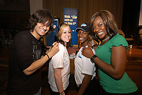 Recording artist David Usher autographs Samantha Zufelt's T-shirt while singer Jully Black signs Krystal Bell's T-shirt at Jarvis Collegiate April 18th at the Toronto launch of this year's Bell Walk for Kids Help Phone (CNW Group/Kids Help Phone)