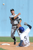 Lexington Legends Ben Orloff #9 makes a turn on a double play against a sliding Rafael Ortega during a game against  the Asheville Tourists at McCormick Field in Asheville,  North Carolina;  April 17, 2011. Lexington defeated Aheville 18-9.  Photo By Tony Farlow/Four Seam Images